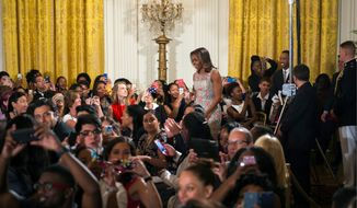 First lady Michelle Obama welcomed over 130 college-bound high school students to the daylong White House event as part of her Reach Higher initiative. (Associated Press)