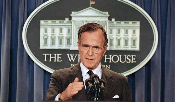 "President George H.W. Bush infamously went back on his 1988 ""no new taxes"" campaign pledge. (Associated Press) ** FILE **"