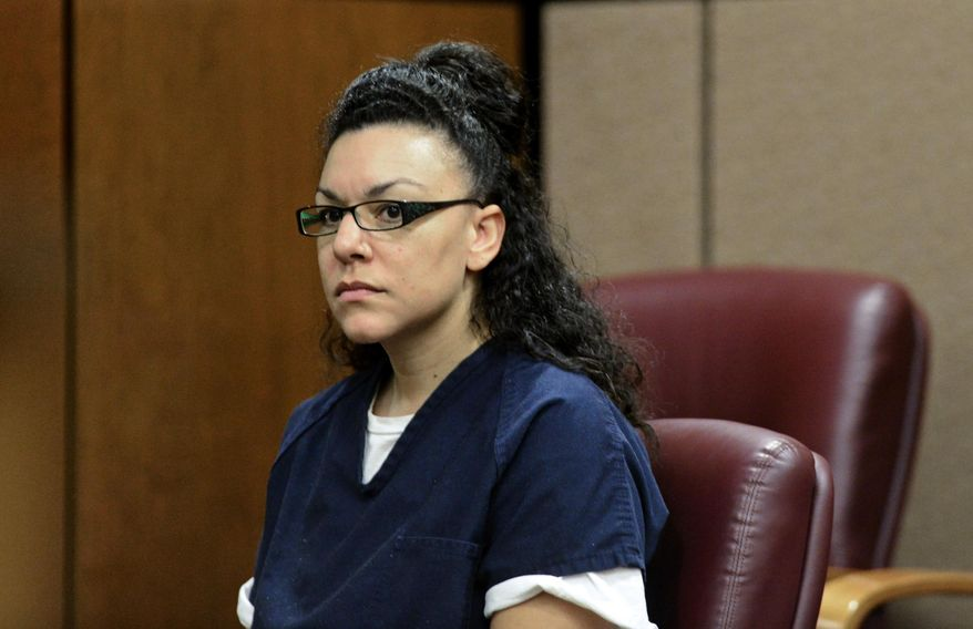 Dynel Lane, accused of attacking Michelle Wilkins and cutting the Longmont woman's unborn child from her womb, is arraigned on attempted-murder charges in Boulder District Court in Boulder, Colo., on Thursday, July 23, 2015. (Matthew Jonas/The Daily Times Call via AP) NO SALES; MANDATORY CREDIT