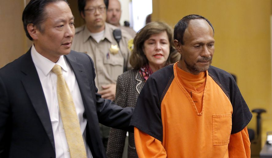 Juan Francisco Lopez-Sanchez (right) is led into the courtroom by San Francisco Public Defender Jeff Adachi and Assistant District Attorney Diana Garciaor for his arraignment at the Hall of Justice in San Francisco on  July 7, 2015. More than 1,800 immigrants that the federal government wanted to deport were nevertheless released from local jails and later re-arrested for various crimes, according to a government report released July 13, 2015. The controversy was re-ignited after 32-year-old Kathryn Steinle was shot to death while walking on a San Francisco pier and authorities arrested suspect Lopez-Sanchez, who was released from jail in April even though immigration officials had lodged a detainer to try to deport him from the country for a sixth time. (Michael Macor/San Francisco Chronicle via Associated Press)