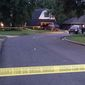 Crime scene tape marks off the area as police investigate on Thursday morning, July 23, 2015, in Broken Arrow, Okla., where authorities say five people were found dead late Wednesday night. Police say a 16-year-old and an 18-year-old, who are both related to the victims, were taken into custody. (AP Photo/Justin Juozapavicius)
