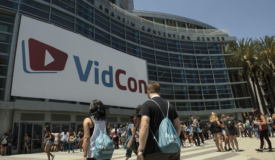 People make their way to the 6th annual VidCon held at the Anaheim Convention Center on Thursday, July 23, 2015, in Anaheim, Calif. The online video event runs July 23-25.  (Ed Crisostomo/The Orange County Register via AP) MAGS OUT; LOS ANGELES TIMES OUT; MANDATORY CREDIT