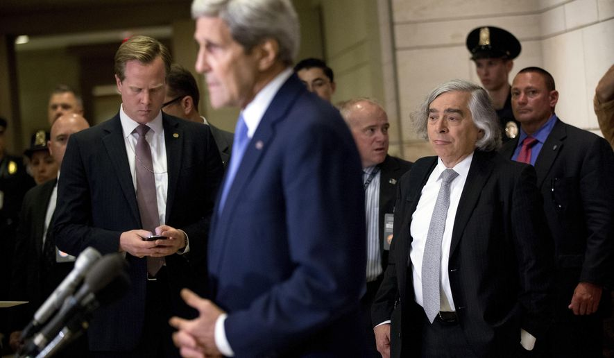 Secretary of State John Kerry, accompanied by Secretary of Energy Ernest Moniz, third from right, gives brief remarks to members of the media before attending a classified briefing for all House members on Capitol Hill, in Washington, Wednesday, July 22, 2015, to speak about the deal reached to curb Iran's nuclear program in exchange for billions of dollars in relief from international sanctions. (AP Photo/Andrew Harnik)