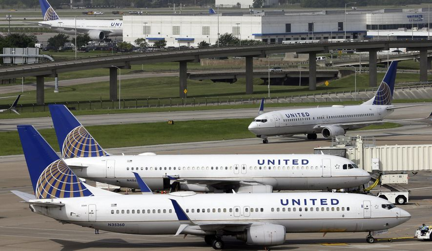 FILE - In this July 8, 2015, file photo, a United Airlines plane, front, is pushed back from a gate at George Bush Intercontinental Airport in Houston. United Airlines reports quarterly financial results on Thursday, July 23, 2015. (AP Photo/David J. Phillip, File)