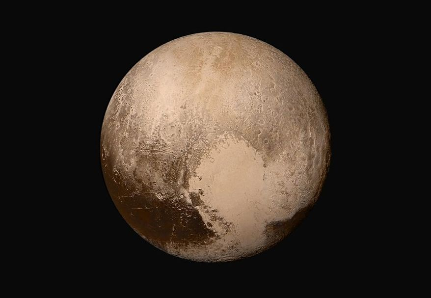 This image made available by NASA on Friday, July 24, 2015 shows Pluto made by combining several images from two cameras on the New Horizons spacecraft. The images were taken when the spacecraft was 280,000 miles (450,000 kilometers) away from Pluto. (NASA/JHUAPL/SwRI via AP)