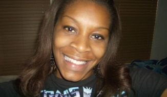 In this undated photo provided by the Bland family, Sandra Bland poses for a photo. The family of Bland, who was found dead in her Texas jail cell, assert that she would not have taken her own life, but authorities are pointing to mounting evidence that they say shows she hanged herself. (Courtesy of Bland family) ** FILE **