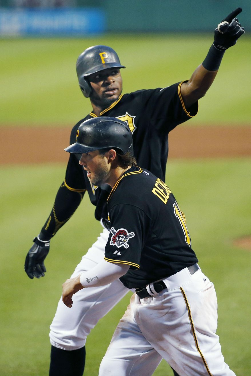 Pittsburgh Pirates' Gregory Polanco, rear, celebrates with teammate Jaff Decker after hitting a two-run home run off Washington Nationals starting pitcher Max Scherzer in the fifth inning of a baseball game in Pittsburgh, Friday, July 24, 2015. (AP Photo/Gene J. Puskar)