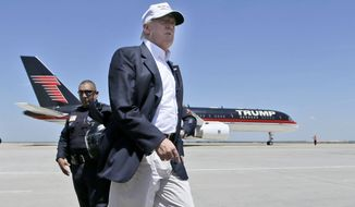 Republican presidential hopeful Donald Trump walks the tarmac before boarding his campaign plane to depart from Laredo, Texas, on July 23, 2015. (Associated Press) ** FILE **