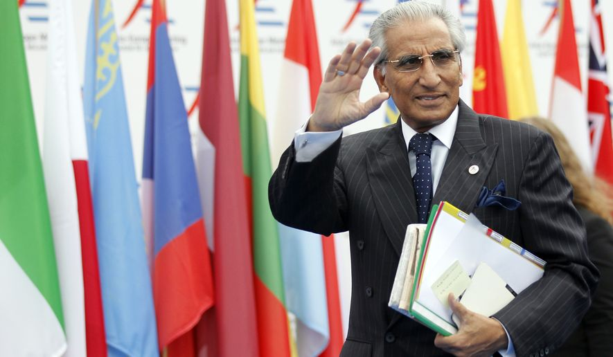 """Pakistan's Special Assistant to Prime Minister on Foreign Affairs Syed Tariq Fatemi arrives for the 10th Asia-Europe Meeting (ASEM) in Milan on Oct. 16, 2014. The two-day summit opens Thursday under the theme """"Responsible Partnership for Sustainable Growth and Security."""" (Associated Press) **FILE**"""