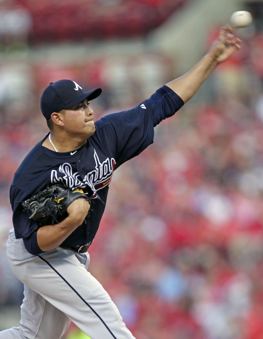 Atlanta Braves starting pitcher Manny Banuelos (60) pitches in the first inning of a baseball game against the St. Louis Cardinals, Friday, July 24, 2015 in St. Louis.(AP Photo/Tom Gannam)