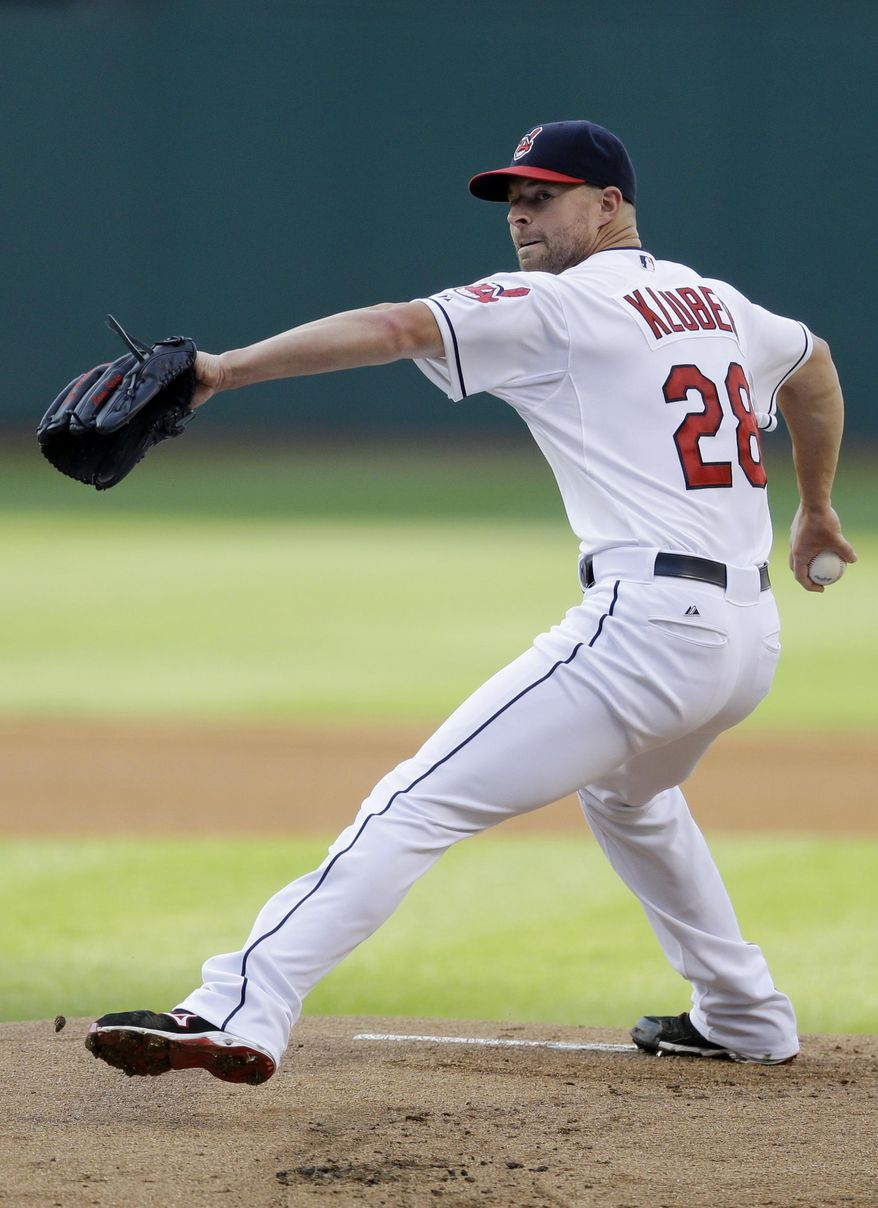 Cleveland Indians starting pitcher Corey Kluber delivers in the first inning of a baseball game against the Chicago White Sox, Friday, July 24, 2015, in Cleveland. (AP Photo/Tony Dejak)