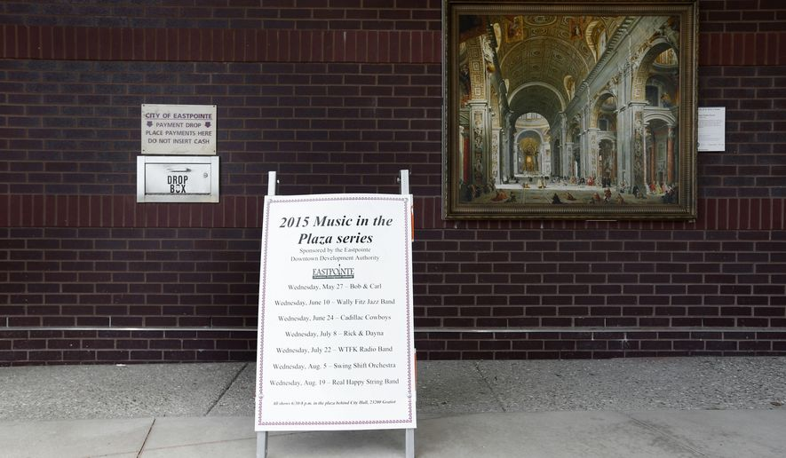 "A reproduction of ""Interior of St. Peter's, Rome"" by Giovanni Paolo Panini hangs outside city hall in Eastpointe, Mich., Friday, July 24, 2015. The Detroit Institute of Arts is installing dozens of artwork reproductions outside in the Detroit area this summer, as its ""Inside/Out"" effort that it started five years ago expands to several other U.S. cities.  (AP Photo/Paul Sancya)"