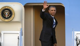 President Barack Obama waves as he boards Air Force One for a trip to Kenya and Ethiopia, on Thursday, July 23, 2015, at Andrews Air Force Base, Md. Obama is the first sitting U.S. president to visit both countries. (AP Photo/Cliff Owen)
