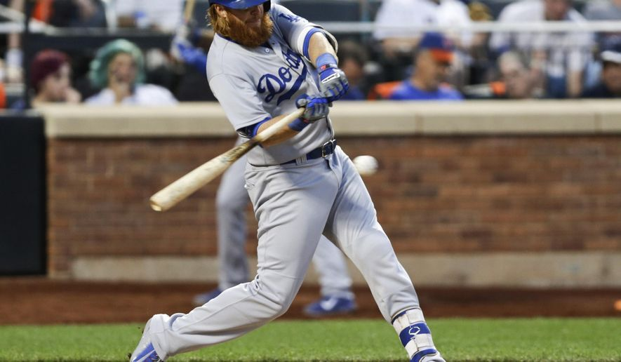 Los Angeles Dodgers' Justin Turner hits a double during the fourth inning of a baseball game against the New York Mets on Friday, July 24, 2015, in New York. (AP Photo/Frank Franklin II)