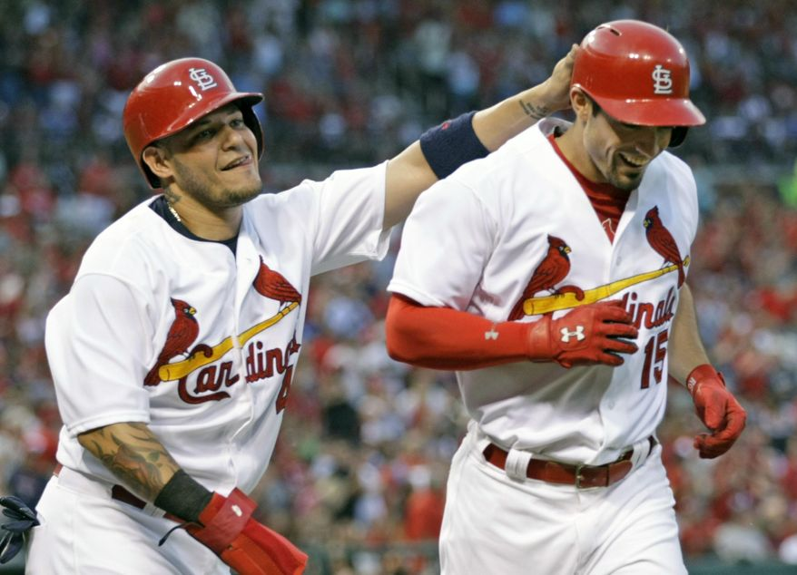 St. Louis Cardinals' Yadier Molina, left, congratulates teammate Randal Grichuk on his two run home run in the second inning of a baseball game against the Atlanta Braves, Friday, July 24, 2015 in St. Louis.(AP Photo/Tom Gannam)