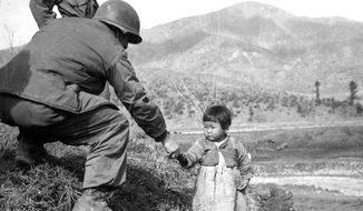 A historical image and a poignant moment from the Korean War  (Defense Department)