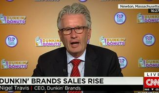 "CEO Nigel Travis of Dunkin' Donuts believes a $15 minimum wage for fast food workers is ""absolutely outrageous."" (CNN)"