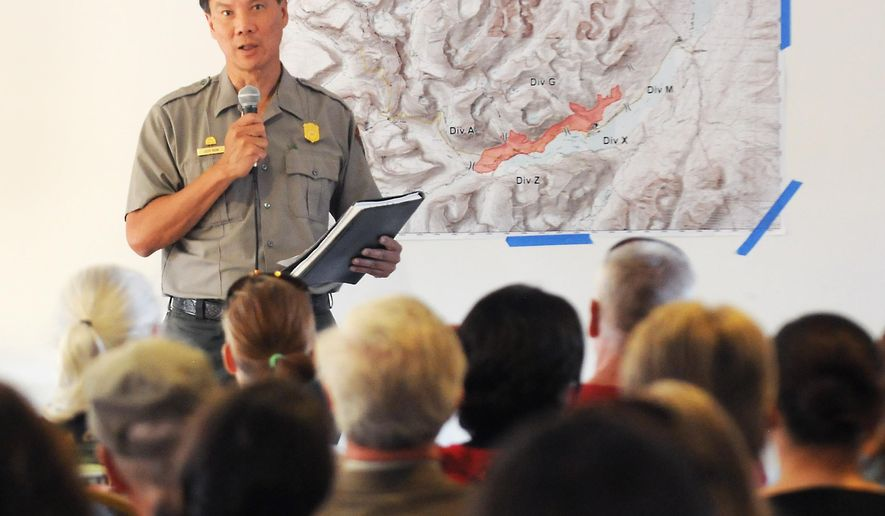 Glacier National Park Superintendent Jeff Mow speaks to the crowd during a public information meeting regarding the wildfires in the national park Friday, July 24, 2015, in St. Mary, Mont. Glacier officials emphasized that only a small part of the 1,718-square-mile park is closed as the flames chew though parched conifer-topped ridges on its eastern side.  (Aaric Bryan/The Daily Inter Lake via AP) MANDATORY CREDIT