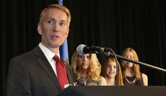 In this Tuesday, Nov. 4, 2014, file photo, then U.S. Rep. James Lankford, R-Okla., newly elected to the Senate, gives his victory speech as his wife, Cindy, and daughters Jordan and Hannah, listen at right, at the Republican watch party in Oklahoma City. (AP Photo/Sue Ogrocki, File)