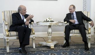 Russian President Vladimir Putin, right, speaks with FIFA President Sepp Blatter during their meeting before the 2018 World Cup preliminary draw in the Konstantin palace in St. Petersburg, Russia, Saturday, July 25, 2015. (Maxim Shipenkov/Pool Photo via AP) ** FILE **