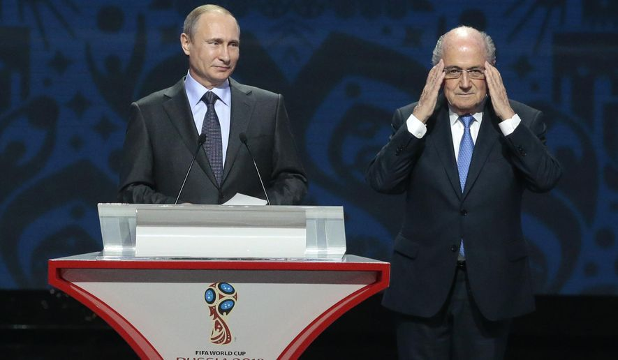 FIFA President Sepp Blatter, right, adjusts his glasses during a speech by Russian President Vladimir Putin during the preliminary draw for the 2018 soccer World Cup in Konstantin Palace in St. Petersburg, Russia, Saturday, July 25, 2015. (AP Photo/Ivan Sekretarev)