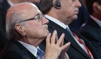 FIFA President Sepp Blatter watches the preliminary draw for the 2018 soccer World Cup in Konstantin Palace in St. Petersburg, Russia, Saturday, July 25, 2015. (AP Photo/Ivan Sekretarev)