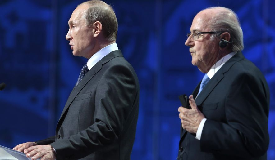 Russian President Vladimir Putin, left, and FIFA President Sepp Blatter open the preliminary draw for the 2018 soccer World Cup in Konstantin Palace in St. Petersburg, Russia, Saturday, July 25, 2015. (AP Photo/Ivan Sekretarev