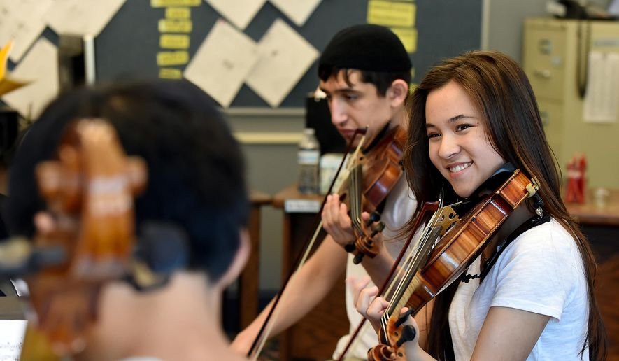FOR RELEASE SATURDAY, JULY 25, 2015, AT 3:00 A.M. PDT. - Erika Nagamoto, 15, of Corvallis, Ore., right, practices a movement from Dvorak Sextet with Doron Grossman-Naples, 17, of Philomath, Ore., during the Oregon State University Chamber Music Workshop Tuesday morning, July 14, 2015 at Ashbrook Independent School in Corvallis, Ore. (Amanda Cowan/The Corvallis Gazette-Times via AP)