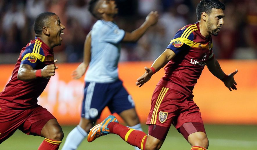 Real Salt Lak's Javier Morales, right, celebrates scoring a goal against Sporting Kansas City during an MLS soccer game, Friday, July 24, 2015. at Rio Tinto Stadium in Sandy, Utah. (Ravell Call/The Deseret News via AP)  SALT LAKE TRIBUNE OUT; MAGS OUT; MANDATORY CREDIT