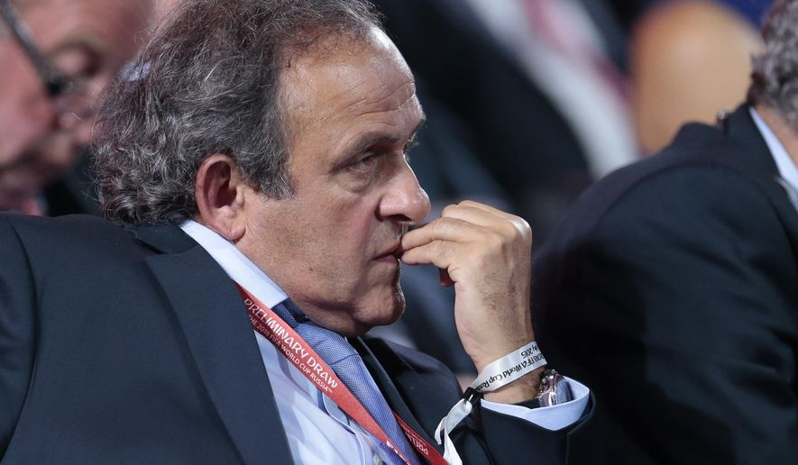 UEFA President Michel Platini watches the preliminary draw for the 2018 soccer World Cup in Konstantin Palace in St. Petersburg, Russia, Saturday, July 25, 2015. (AP Photo/Ivan Sekretarev