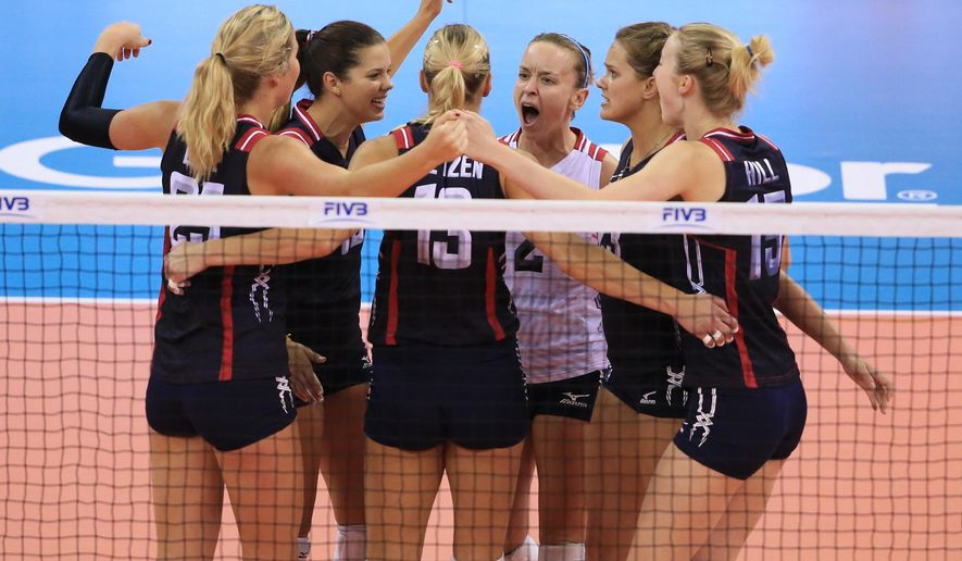 United States players including Kayla Banwarth (2) celebrate a point against Brazil in a women's FIVB World Grand Prix volleyball match in Omaha, Neb., Saturday, July 25, 2015. (AP Photo/Nati Harnik)