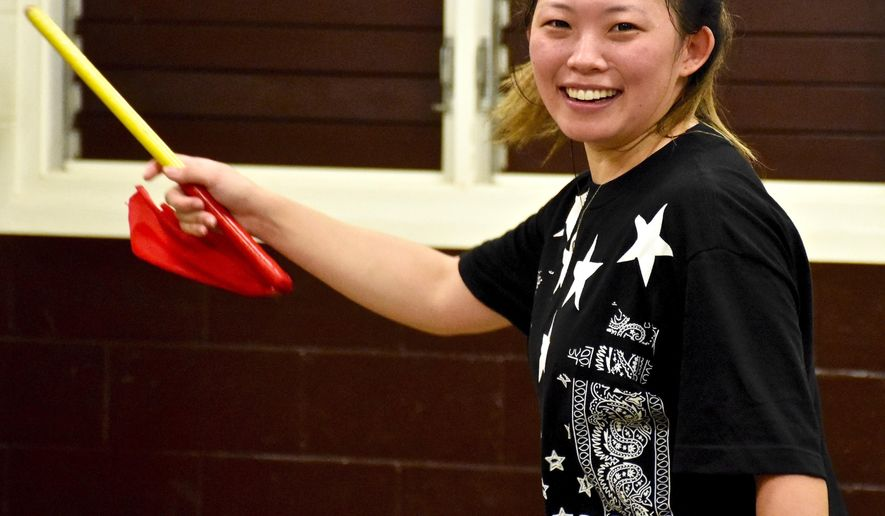 ADVANCE FOR SUNDAY JULY 26, 2015 In this Tuesday, July 14, 2015 photo, Zumba instructor Nicole Morris works with the Ryukyukoku Matsuri Daiko ensemble in Kauai, Hawaii. Morris said getting certified in Zumba instruction is in line with her plans for her future of helping the elderly and young people with special needs. (Dennis Fujimoto/ The Garden Island via AP)
