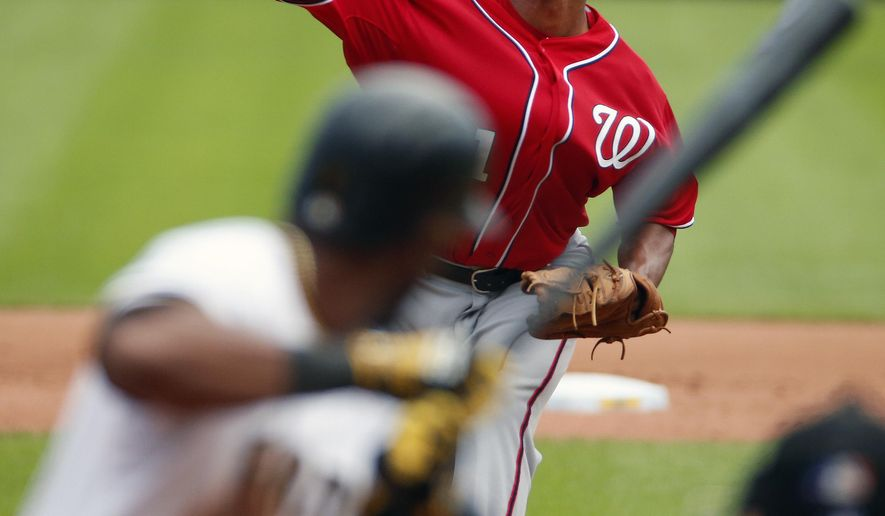 Washington Nationals starting pitcher Joe Ross, top, delivers to Pittsburgh Pirates' Starling Marte in the fifth inning of a baseball game in Pittsburgh, Sunday, July 26, 2015. The Pirates won 3-1. (AP Photo/Gene J. Puskar)