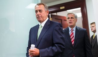 House Speaker John A. Boehner, Ohio Republican, last week brushed aside questions about the Confederate battle flag, saying conversations are continuing. He said Majority Leader Kevin McCarthy, California Republican, was his point man on the matter. (Associated Press)