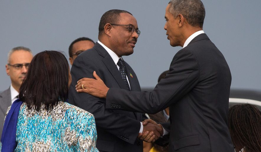 President Obama shakes hands with Ethiopian Prime Minister Hailemariam Desalegn after arriving at Addis Ababa Bole International Airport Sunday. Mr. Obama is the first sitting U.S. president to visit Ethiopia. His trip also included a stop in Kenya, the homeland of his late father. (Associated Press)