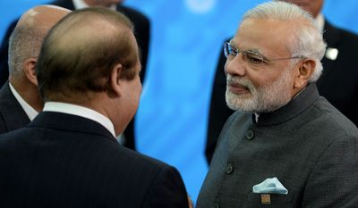 Indian Prime Minister Narendra Modi (right) and Pakistani Prime Minister Muhammad Nawaz Sharif made headlines this month by engaging in a face-to-face meeting on the sidelines of economic and security summits in the Russian city of Ufa. (Associated Press)