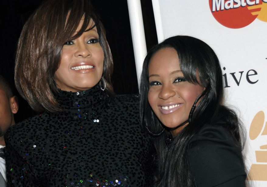 In this Feb. 12, 2011, file photo, singer Whitney Houston, left, and daughter Bobbi Kristina Brown arrive at an event in Beverly Hills, Calif. Brown, who was in hospice after months of receiving medical care, died on Sunday, July 26, 2015. (AP Photo/Dan Steinberg, File)