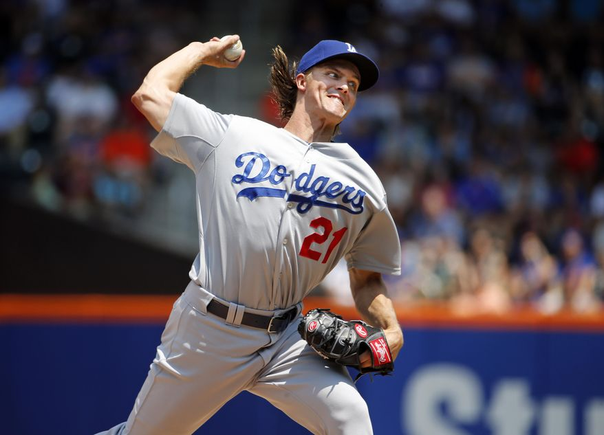 Los Angeles Dodgers starting pitcher Zack Greinke delivers in the first inning of a baseball game against the New York Mets in New York, Sunday, July 26, 2015. (AP Photo/Kathy Willens)