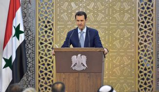 "In this photo released by the Syrian official news agency SANA, Syrian President Bashar Assad delivers a speech in Damascus, Syria, Sunday, July 26, 2015. Assad says he supports any political dialogue to end his country's civil war even if its effects are limited. But he says any initiative that is not based on fighting ""terrorism"" will be ""hollow"" and ""meaningless."" (SANA via AP)"