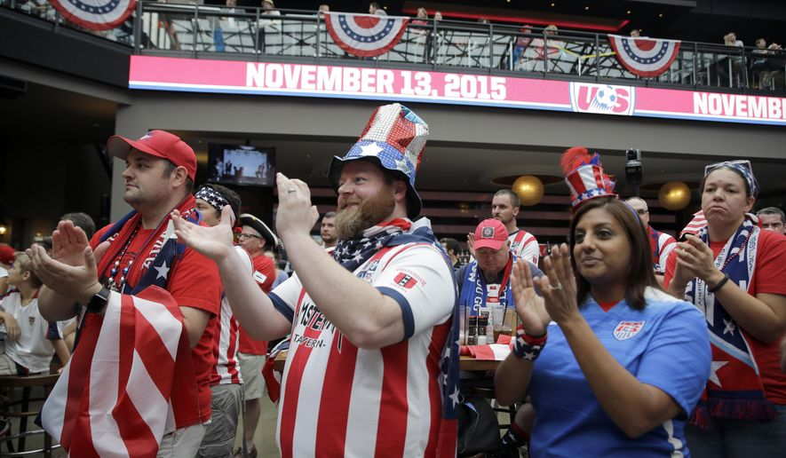 Soccer fans applaud during a news conference Monday, July 27, 2015, in St. Louis. The news conference was held to announce the U.S. soccer team will play its first qualifier for the 2018 World Cup at Busch Stadium in St. Louis on Nov. 13, 2015. (AP Photo/Jeff Roberson)