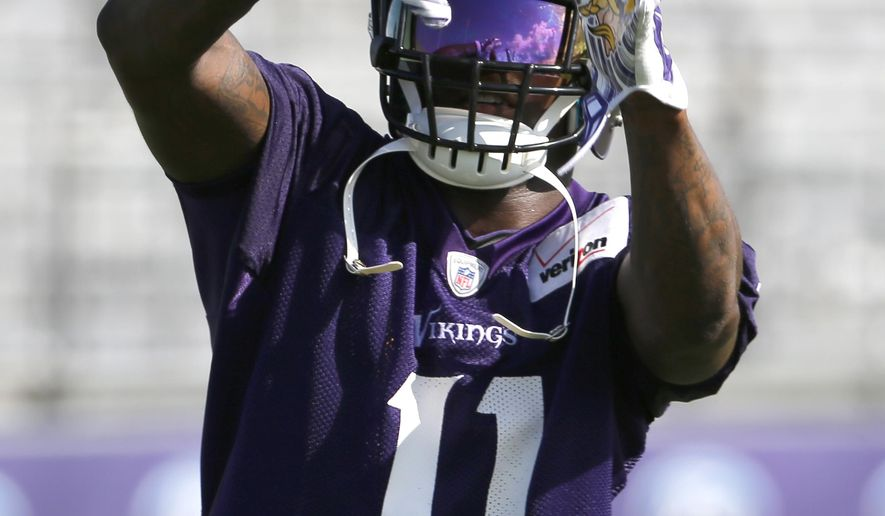 Minnesota Vikings wide receiver Mike Wallace catches a pass during practice at an NFL football training camp on the campus of Minnesota State University, Sunday, July 26, 2015, in Mankato, Minn. (AP Photo/Charles Rex Arbogast)