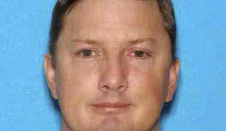 This undated Oregon driver identification photo released Monday, July 27, 2015, by the Charleston, W. Va., Police Department shows Neal Falls, of Springfield, Ore., killed by a women he attacked on July 18 in Charleston. Police are investigating whether Falls had any connection to cases of suspicious deaths and missing women in other states. (Oregon DMV/Charleston Police Department via AP)