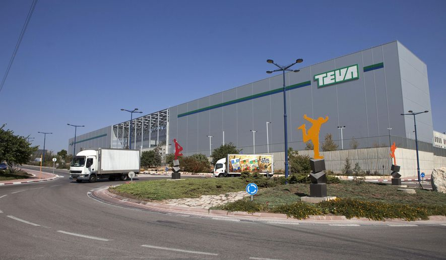 FILE - This Wednesday, Oct. 16, 2013 file photo shows trucks run past Teva Pharmaceutical Logistic Center in the town of Shoam, Israel. Israel's Teva Pharmaceutical Industries Ltd. said Monday it is purchasing Dublin-based Allergan PLC's generic pharmaceuticals business for $40.5 billion, in what Israeli analysts called the largest-ever acquisition by an Israeli company. (AP Photo/Dan Balilty, File)