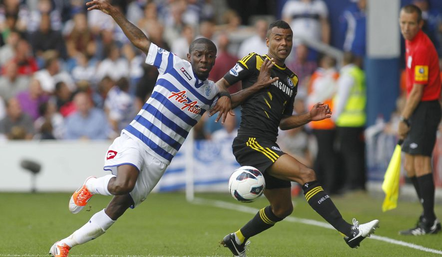 FILE - In this Saturday, Sept. 15, 2012 file photo, Queens Park Rangers' Shaun Wright-Phillips, left, competes with Chelsea's Ashley Cole during their English Premier League soccer match at Loftus Road stadium, London. The New York Red Bulls have signed the brother of defending MLS leading goal-scorer Bradley Wright-Phillips. Red Bulls sporting director Ali Curtis announced on Monday, July 27, 2015 that midfielder Shaun Wright-Phillips will be joining his brother on the team. (AP Photo/Sang Tan, file)