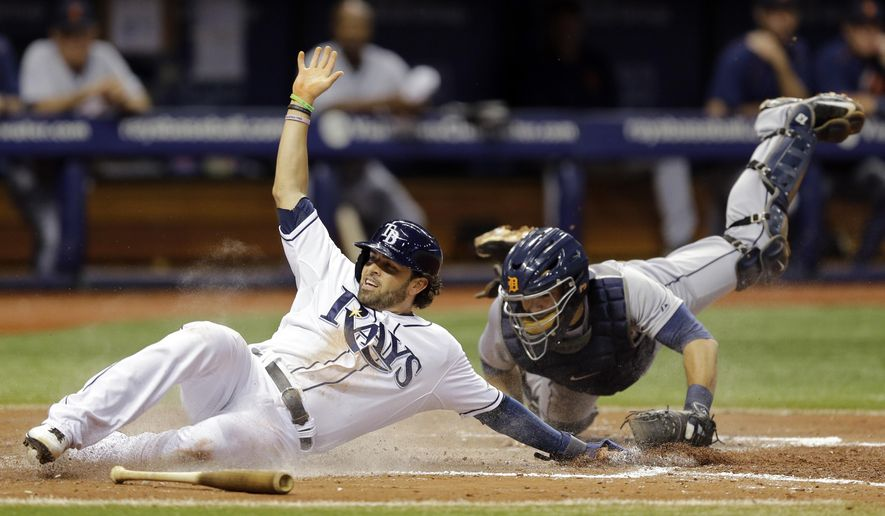 Tampa Bay Rays' David DeJesus, left, slides around the tag from Detroit Tigers catcher Alex Avila while scoring on an RBI single by Logan Forsythe during the fifth inning of a baseball game Monday, July 27, 2015, in St. Petersburg, Fla.  (AP Photo/Chris O'Meara)