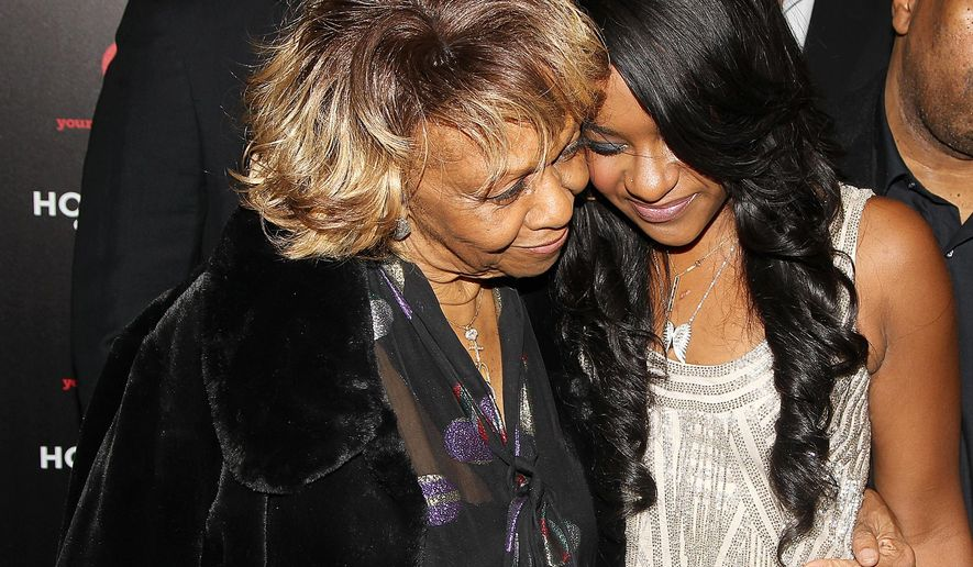 """FILE- In this Oct. 22, 2012, file photo, singer Cissy Houston and her granddaughter Bobbi Kristina Brown attend the premiere party for """"The Houstons On Our Own"""" at the Tribeca Grand hotel in New York. Brown, daughter of the late entertainer Whitney Houston and R&B singer Bobby Brown, died Sunday, July 26, 2015, several months after she was found face-down and unresponsive in a bathtub. She was 22 years old. (Photo by Donald Traill/Invision/AP, File)"""