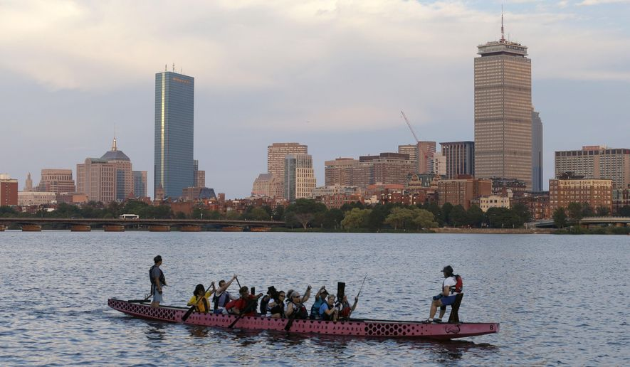 A boat glides along the Cambridge, Mass., side of the Charles River, Monday, July 27, 2105, in front of the Boston skyline, behind. The U.S. Olympic Committee officially severed ties with Boston on Monday, saying it was exploring other options amid lackluster public support and concerns from elected leaders and organized opposition about the impact to taxpayers. (AP Photo/Steven Senne)