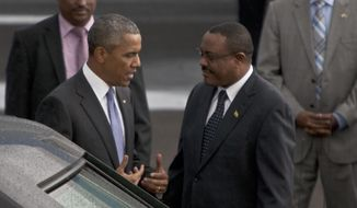 President Barack Obama with Ethiopian Prime Minister Hailemariam Desalegn, right, at Bole International Airport  Addis Ababa, Ethiopia, Sunday, July 26, 2015.  Obama is traveling on a two-nation African tour where he will become the the first sitting U.S. president to visit Kenya and Ethiopia.  (AP Photo/Sayyid Azim)