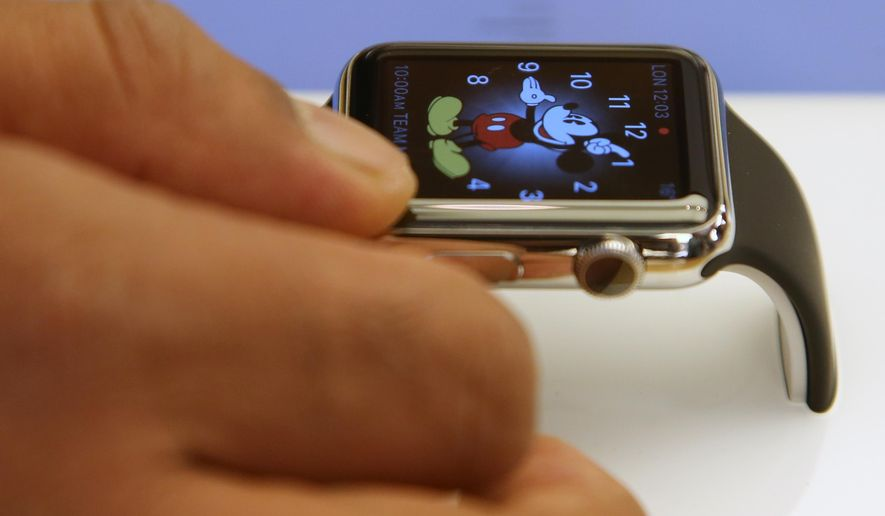 FILE - In this April 10, 2015 file photo, a customer handles an Apple Watch at an Apple store in Sydney. U.S. retailer Best Buy Co. says it will sell the Apple Watch at 100 of its stores and on its website beginning Aug. 7, 2015. (AP Photo/Rick Rycroft)