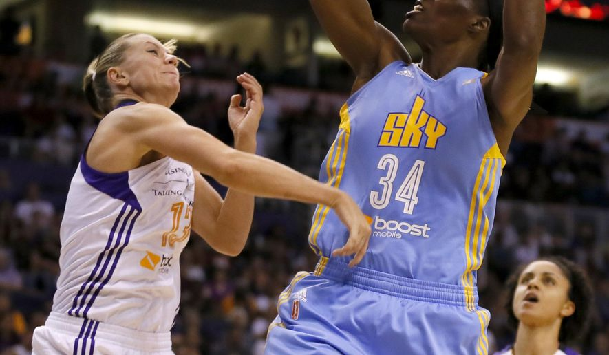 FILE - In this Sept. 9, 2014, file photo, Chicago Sky' Sylvia Fowles (34) shoots over Phoenix Mercury forward Penny Taylor during the second half of  Game 2 of the WNBA basketball finals in Phoenix. The Chicago Sky have traded center Sylvia Fowles to the Minnesota Lynx as part of a three-team deal. The Sky on Monday, July 27, 2015,  acquired Erika De Souza from Atlanta and also give the Lynx their second-round pick in next year's draft. (AP Photo/Matt York, File)